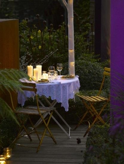 las velas la opcin ideal para iluminar la mesa en una cena de verano romntica