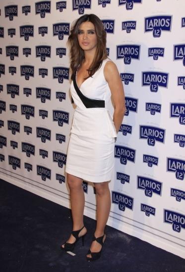 Foto Sara Carbonero con vestido corto blanco